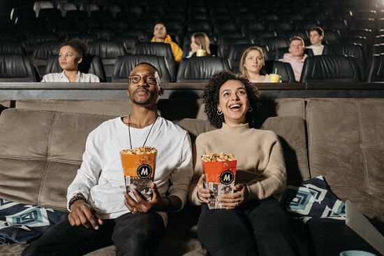 Young people enjoying a movie | DIRECTV PREMIER™ channels