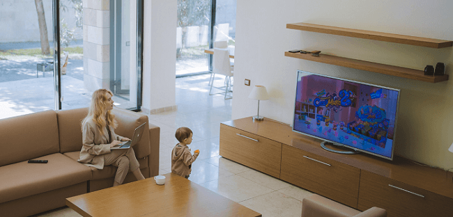 Mother and and child watching a channels on DStv access